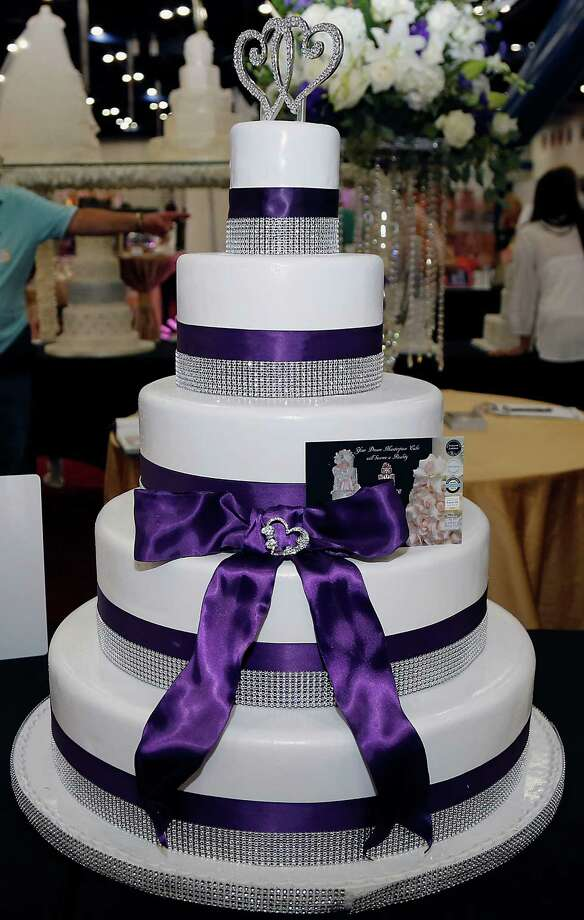 A cake from Supreme Kakes booth during the 30th Bi-Annual Bridal Extravaganza Show at the George R. Brown Convention Center. Photo: James Nielsen, Houston Chronicle / © 2014  Houston Chronicle