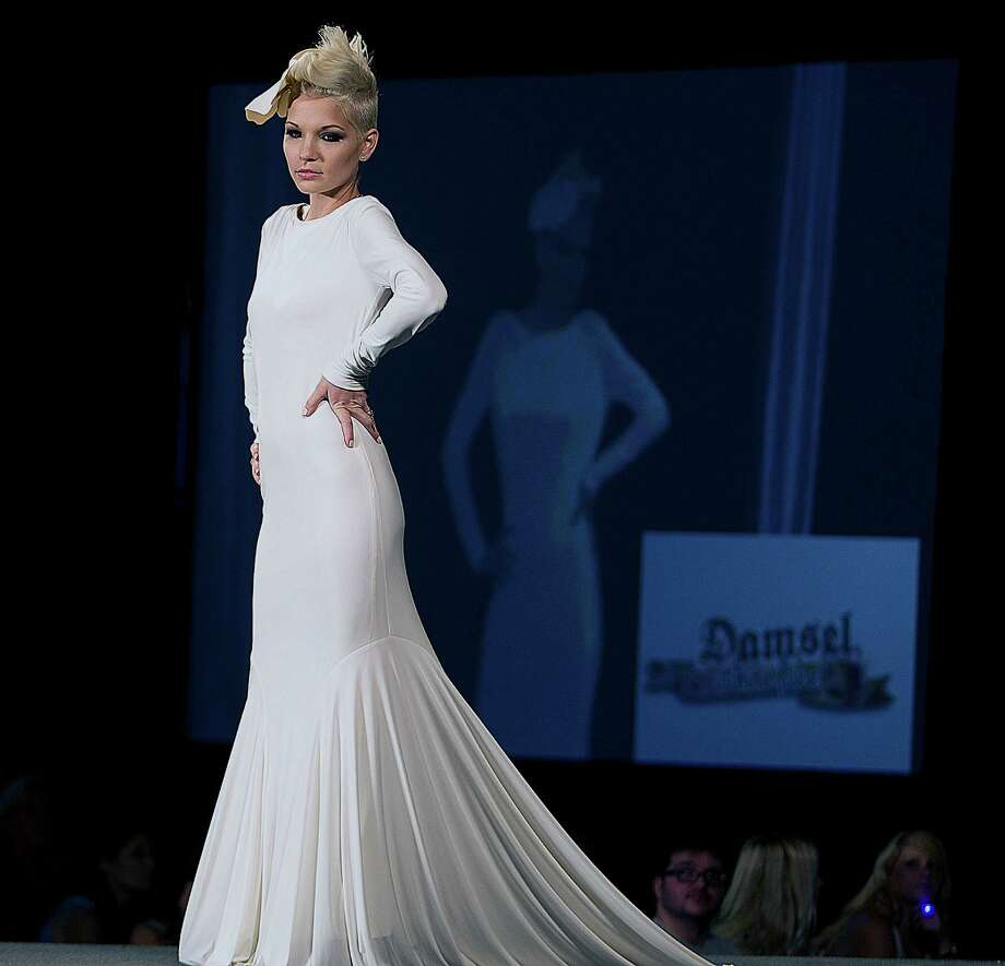 A model walks the runway during the Damsel White Label bridal fashion show at the 30th Bi-Annual Bridal Extravaganza Show at the George R. Brown Convention Center. Photo: James Nielsen, Houston Chronicle / © 2014  Houston Chronicle