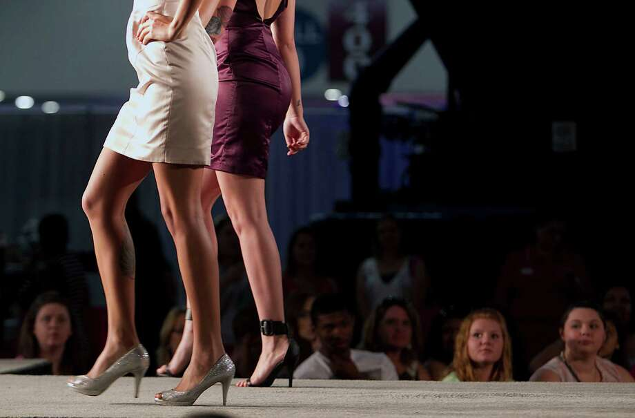 Models walk on the runway during the Damsel White Label bridal fashion show at the 30th Bi-Annual Bridal Extravaganza Show at the George R. Brown Convention Center. Photo: James Nielsen, Houston Chronicle / © 2014  Houston Chronicle
