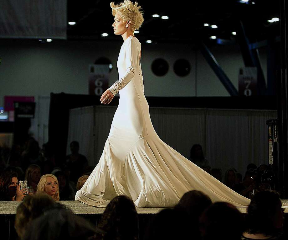 A model walks on the runway during the Damsel White Label bridal fashion show at the 30th Bi-Annual Bridal Extravaganza Show at the George R. Brown Convention Center. Photo: James Nielsen, Houston Chronicle / © 2014  Houston Chronicle