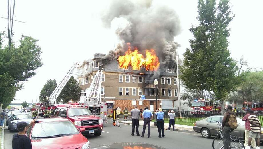 Firefighters are battling a fire that has destroyed much of a four story building on the city's east end Saturday afternoon. Photo: Contributed Photo / Connecticut Post Contributed