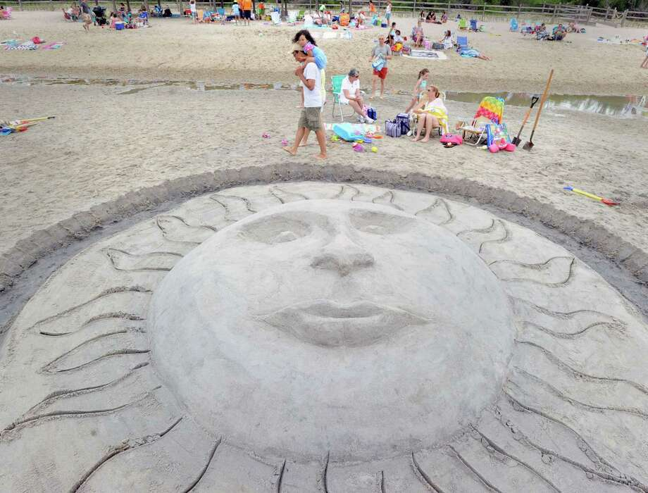 A sculpture of the sun was done by husband and wife, Ed and Pam Tomer of Cos Cob and Tim Mund of Riverside during the Greenwich Arts Council and the Town of Greenwich Department of Parks and Recreation's Sandblast Sand Sculpture Festival at Greenwich Point, Saturday afternoon, July 19, 2014. Photo: Bob Luckey / Greenwich Time