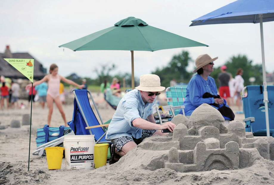 Teek Eaton-Koch of Riverside constructs a sand casstle during the Greenwich Arts Council and the Town of Greenwich Department of Parks and Recreation's Sandblast Sand Sculpture Festival at Greenwich Point, Saturday afternoon, July 19, 2014. Photo: Bob Luckey / Greenwich Time