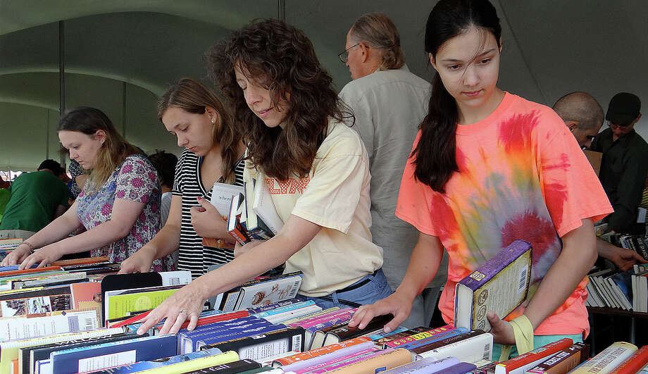 Marie Beaumonte of Norwalk abd daughter, Kristen, 13, browse the Teen section at the Westport Library's Summer Book Sale on Saturday morning. Photo: Mike Lauterborn / Westport News