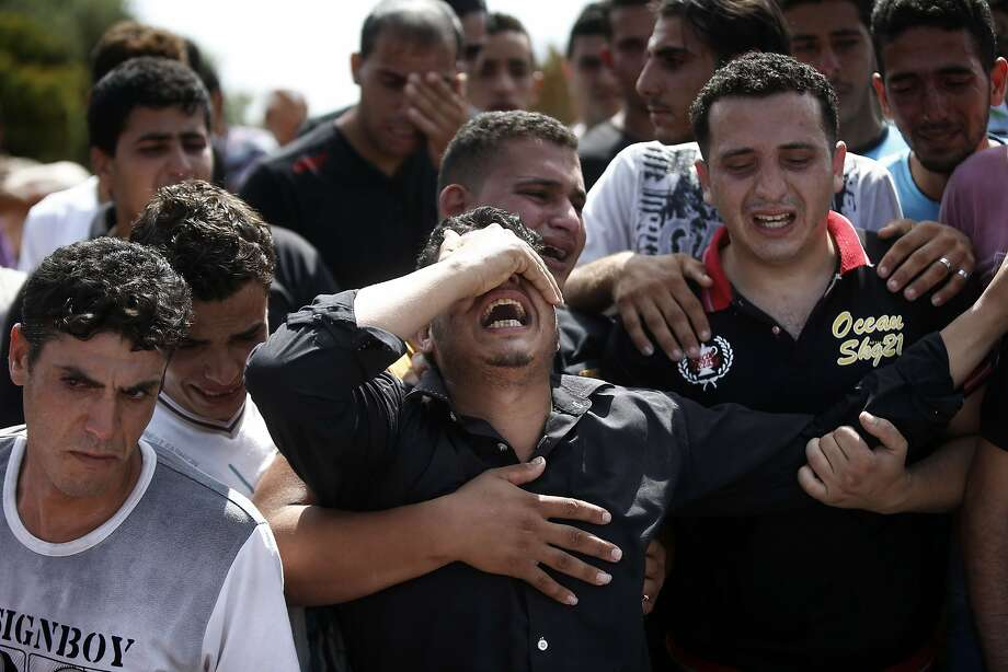 Palestinians mourn at the funeral of eight family members killed in an Israeli strike on Beit Lahiya. Photo: Thomas Coex, AFP/Getty Images