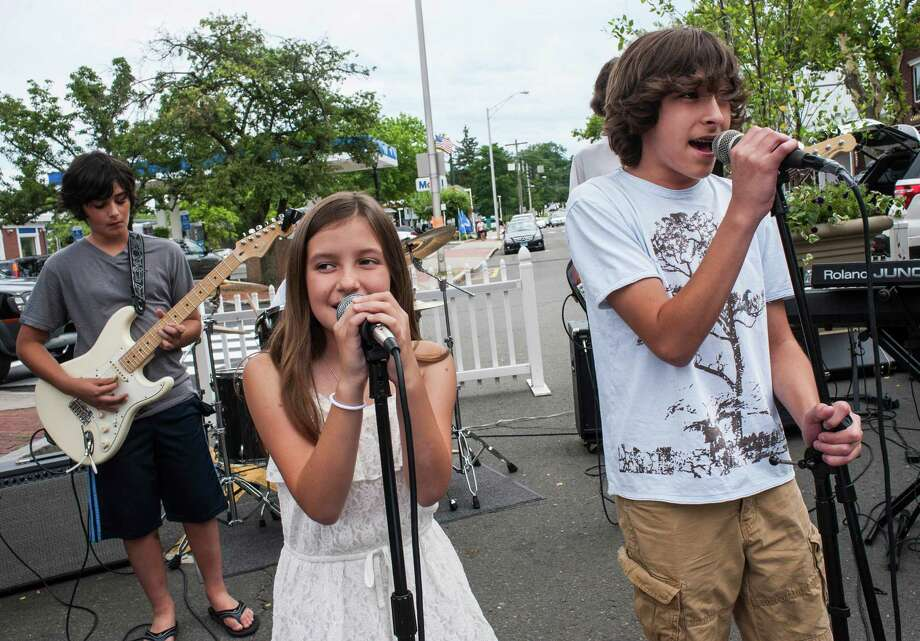 "The New Canaan ""School of Rock"" band vocalists Addie Teolis and Ben Teolis sing at the annual New Canaan Village Fair & Sidewalk Sale, New Canaan, CT Saturday, July, 19th, 2014. Photo: Mark Conrad / Connecticut Post Freelance"