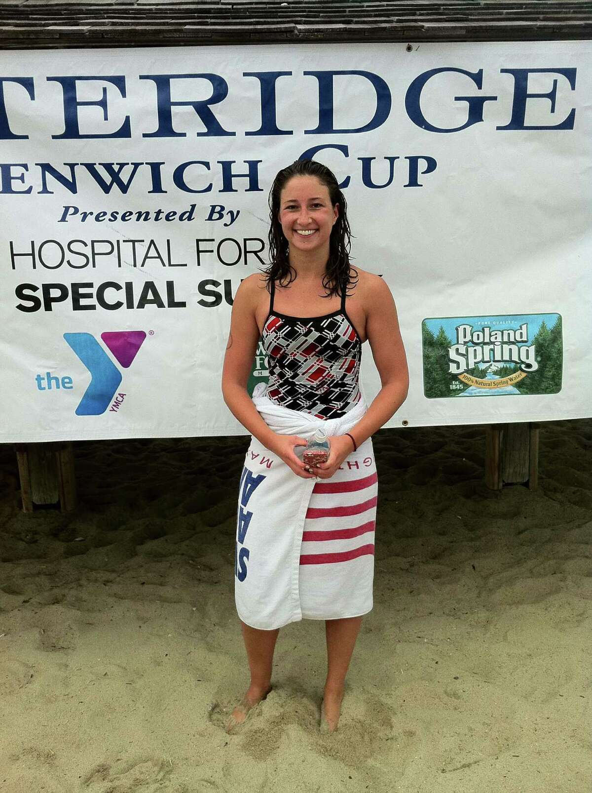 Danielle Honrath, a Monroe native, was the overall woman's champion of the Greenwich Point One-Mile Swim on Saturday. She finished the race in 16 minutes, 59 seconds.