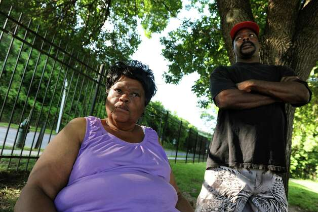 Residents Annie Ellis, left, and Zebedee Lawson talk about living next to the rail line that carries oil tankers to the Port of Albany on Thursday, June 19, 2014, at Ezra Prentice Homes in Albany, N.Y. (Cindy Schultz / Times Union) Photo: Cindy Schultz