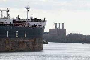 The oil tanker Afrodite is maneuvered to the Buckeye Partners oil terminal at the Port of Albany Monday, Oct. 28, 2013, in Albany, N.Y.  The tanker will be filled with crude oil which it will transport down the Hudson River. (Will Waldron/Times Union)