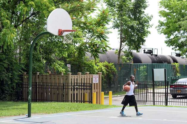 The basketball court and playground are right next to the rail line that carries oil tankers to the Port of Albany  Wednesday, July 16, 2014, at Ezra Prentice Homes in Albany, N.Y. (Cindy Schultz / Times Union) Photo: Cindy Schultz / 00027815A