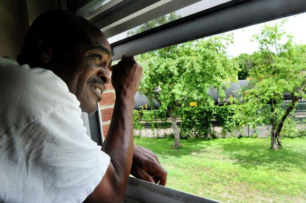 Bebe White, vice president of the Ezra Prentice Tenant Assoc., looks out his window at the rail line that carries oil tankers to the Port of Albany  Wednesday, July 16, 2014, at Ezra Prentice Homes in Albany, N.Y. (Cindy Schultz / Times Union) Photo: Cindy Schultz / 00027815A