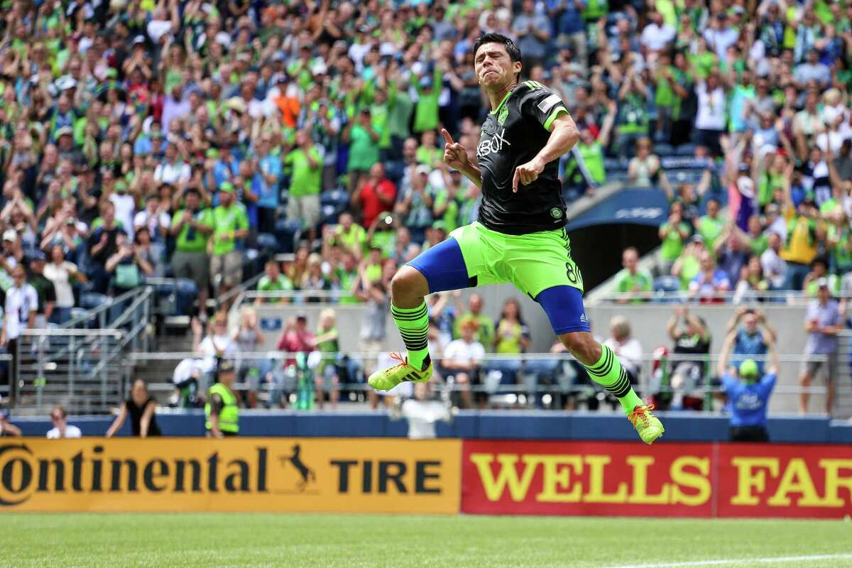 Midfielder Gonzalo Pineda celebrates after scoring on a penalty kick during the Seattle Sounders FC friendly against Tottenham Hotspur of the English Premier League on Saturday, July 19, 2014. The match ended in a 3-3 draw.