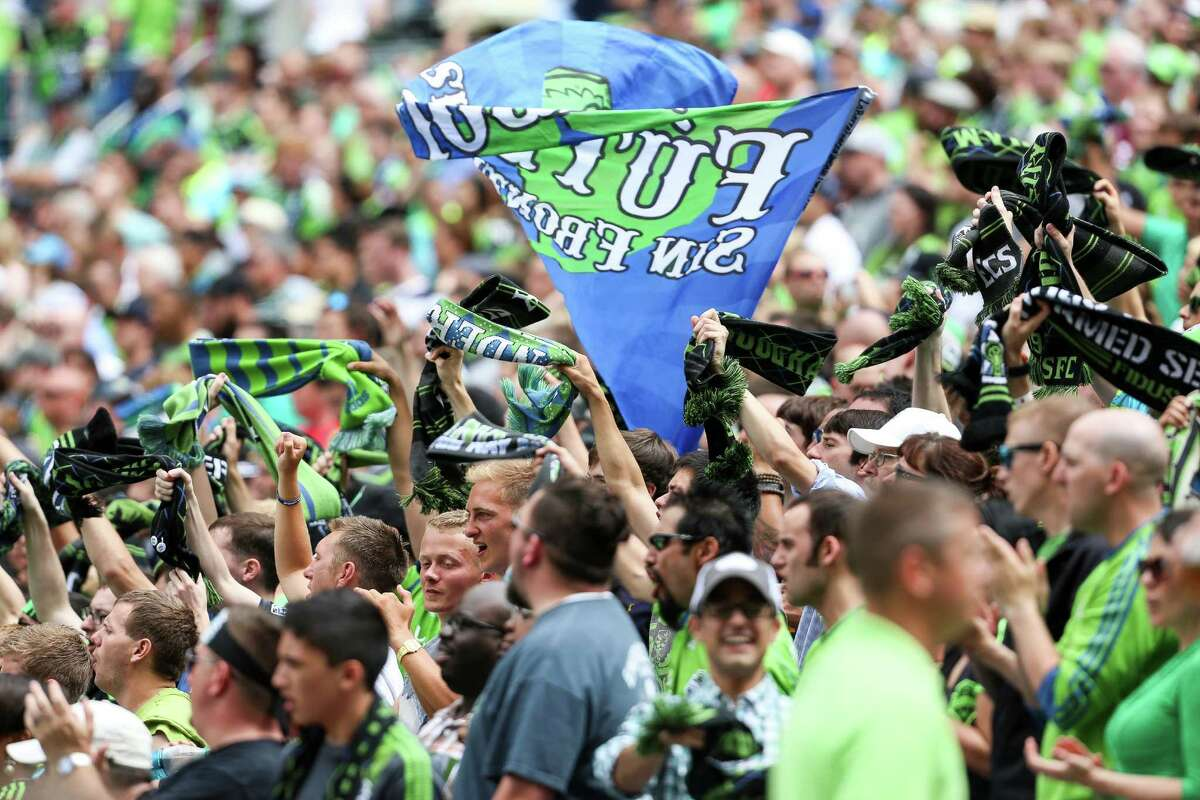 Fans cheer during the Seattle Sounders FC friendly against Tottenham Hotspur.