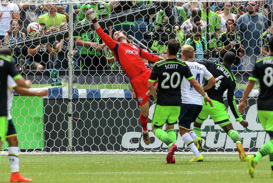 Goalkeeper Stefan Frei misses a save to give Tottenham an early 1-0 lead. Photo: JOSHUA BESSEX, SEATTLEPI.COM / SEATTLEPI.COM