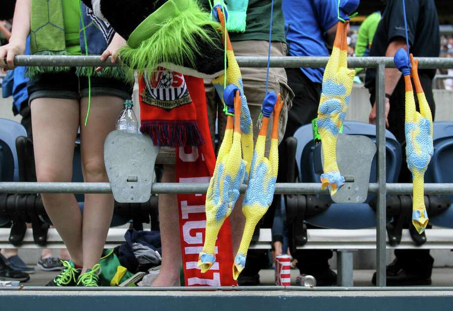 Fans hang rubber chickens from the railing. Photo: JOSHUA BESSEX, SEATTLEPI.COM / SEATTLEPI.COM