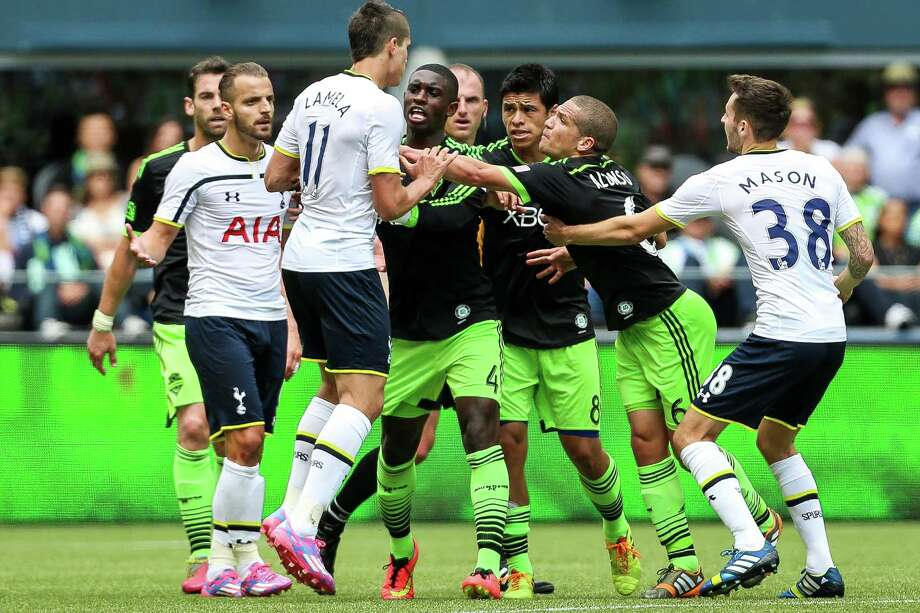A tussle breaks out between players. Photo: JOSHUA BESSEX, SEATTLEPI.COM / SEATTLEPI.COM