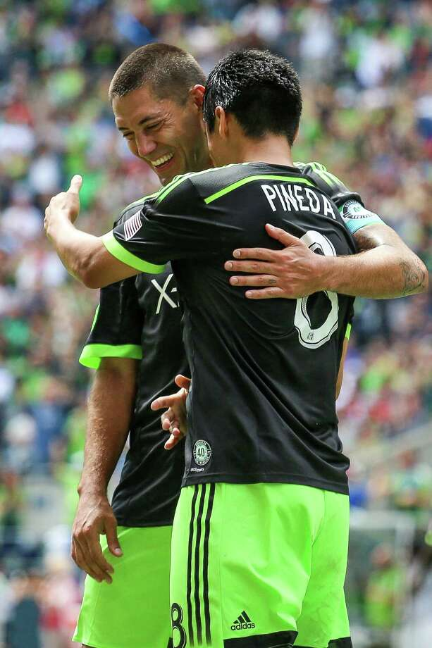 Midfielder Gonzalo Pineda (8) celebrates after scoring on a penalty kick during the Seattle Sounders FC friendly against the Tottenham Hotspur on Saturday, July 19, 2014. The match ended in a 3-3 draw. Photo: JOSHUA BESSEX, SEATTLEPI.COM / SEATTLEPI.COM