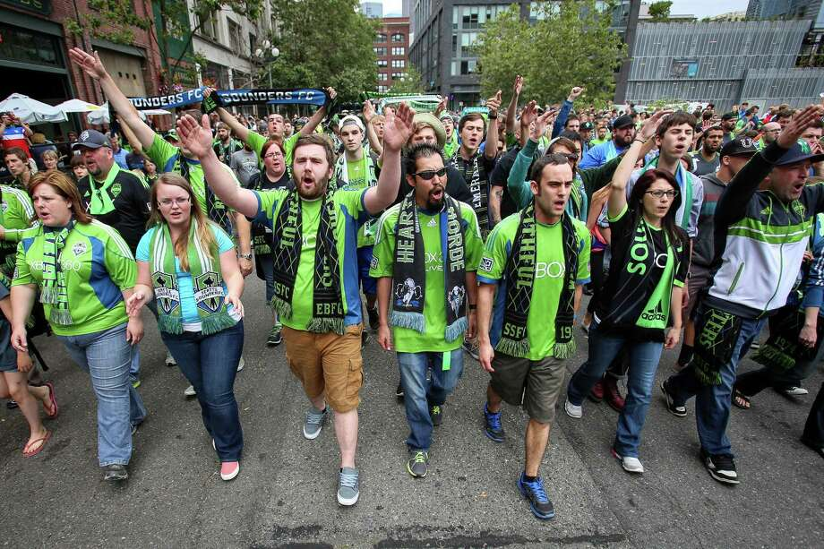 Fans march to the match from Occidental Park. Photo: JOSHUA BESSEX, SEATTLEPI.COM / SEATTLEPI.COM