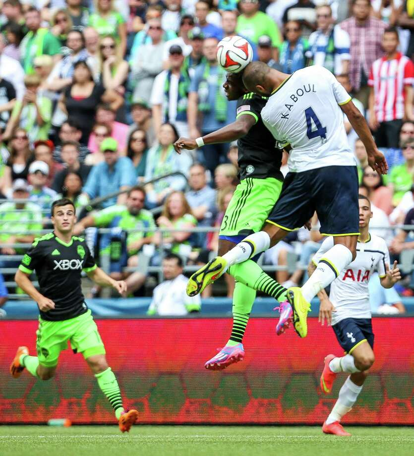 Sean Okoli (13) and Tottenham's Younes Kaboul fight for possession. Photo: JOSHUA BESSEX, SEATTLEPI.COM / SEATTLEPI.COM