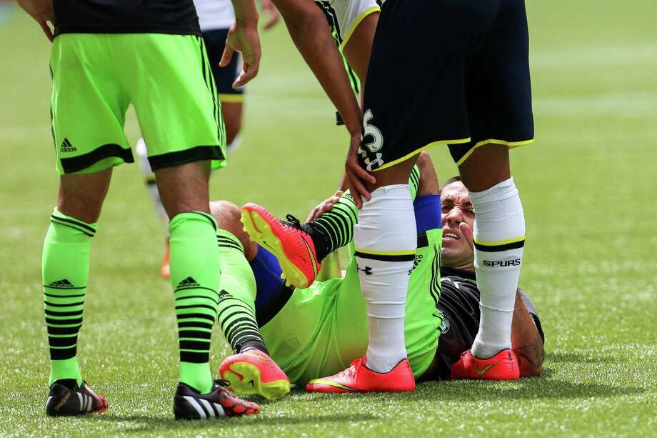 Forward Clint Dempsey holds his knee after falling. Photo: JOSHUA BESSEX, SEATTLEPI.COM / SEATTLEPI.COM