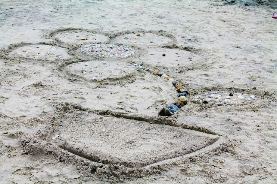Imaginative sculptures rose from the sand at Tod's Point Beach during the annual Greenwich Sand Blast Sculpture competition on July 19, 2014. The event is sponsored by the Greenwich Arts Council and the Parks and Recreation Department. Were you SEEN? Photo: Michelle Russo / Hearst Connecticut Media Group