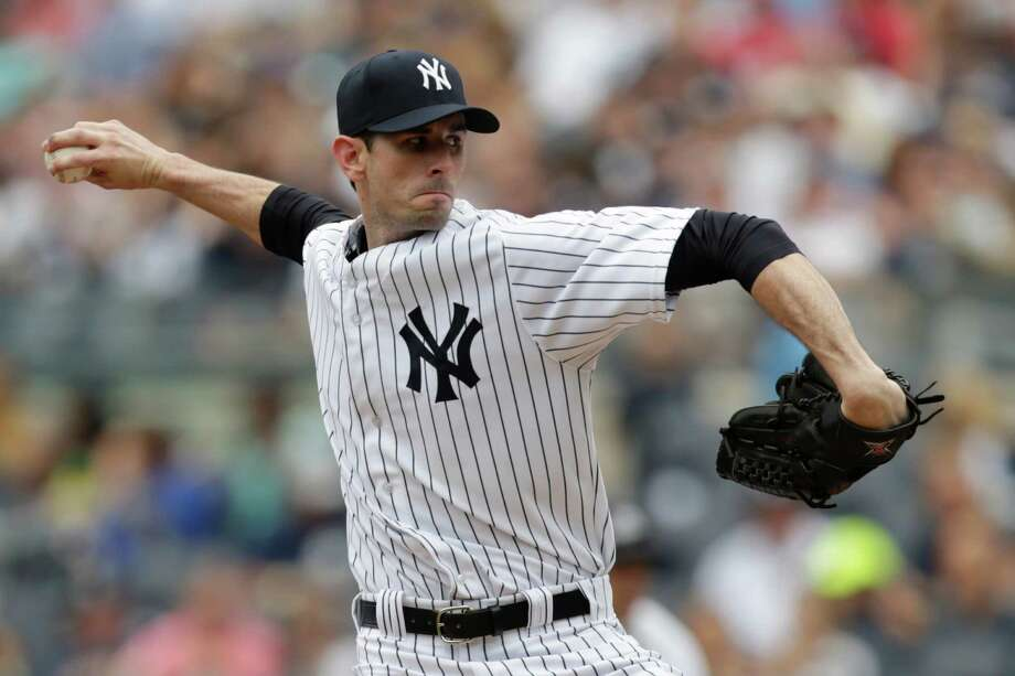 New York Yankees starting pitcher Brandon McCarthy throw during the first inning of a baseball game against the Cincinnati Reds, Saturday, July 19, 2014, at Yankee Stadium in New York. (AP Photo/Julio Cortez) ORG XMIT: NYY101 Photo: Julio Cortez / AP