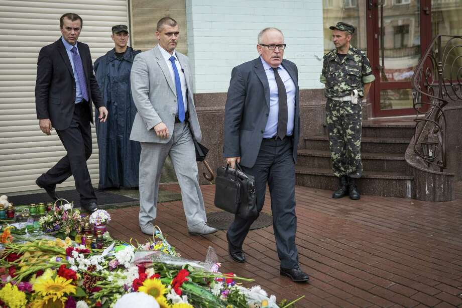 KIEV, UKRAINE - JULY 19:  Dutch Minister of Foreign Affairs Frans Timmermans (front) leaves the Netherlands Embassy on July 19, 2014 in Kiev, Ukraine. Malaysia Airlines flight MH17 was travelling from Amsterdam to Kuala Lumpur when it crashed killing all 298 on board including 80 children. The aircraft was allegedly shot down by a missile and investigations continue over the perpetrators of the attack.  (Photo by Rob Stothard/Getty Images) ORG XMIT: 502446295 Photo: Rob Stothard / 2014 Getty Images