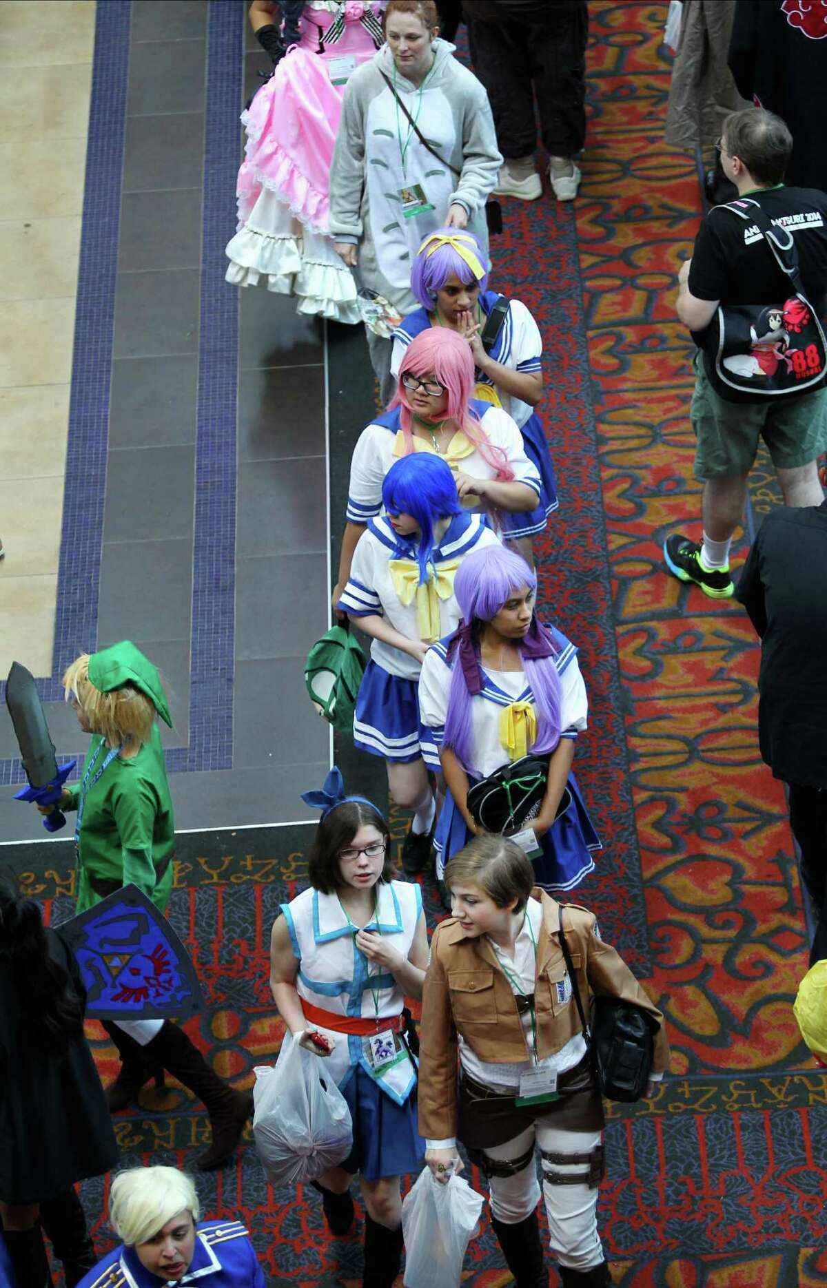 Attendees of the second day of the San Japan: Samurai 7 anime convention walk through the Henry B. Gonzalez Convention Center in San Antonio on Saturday, July 19, 2014.