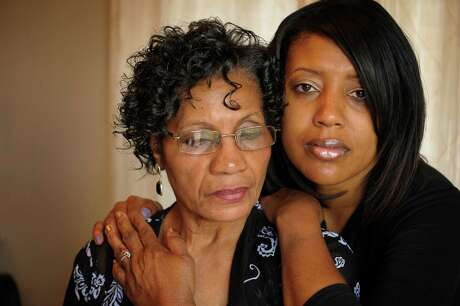 Sylvia Brown, left, and Danielle Summerville, mother and sister of murder victim Donta Summerville, are skeptical and unhappy with HPD. After more than three years of silence, they were told the killing was committed by a man who died two years ago.