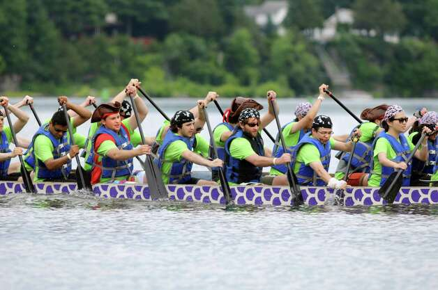 The Buccaneers of Buoyancy paddle to the starting line during the Dragon Boat Festival on Saturday, July 19, 2014, on the Mohawk River in Alplaus, N.Y. The event, featuring paddle race heats, prizes and food, helped raise funds for the Regional Food Bank of Northeastern New York. (Cindy Schultz / Times Union) Photo: Cindy Schultz / 00027551A