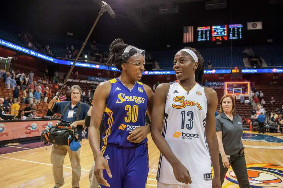 On opposite sides for the first time in their careers, the Sparks' Nneka Ogwumike, left, and sister Chiney of the Sun leave the court side by side. Photo: Tali Greener / Houston Chronicle