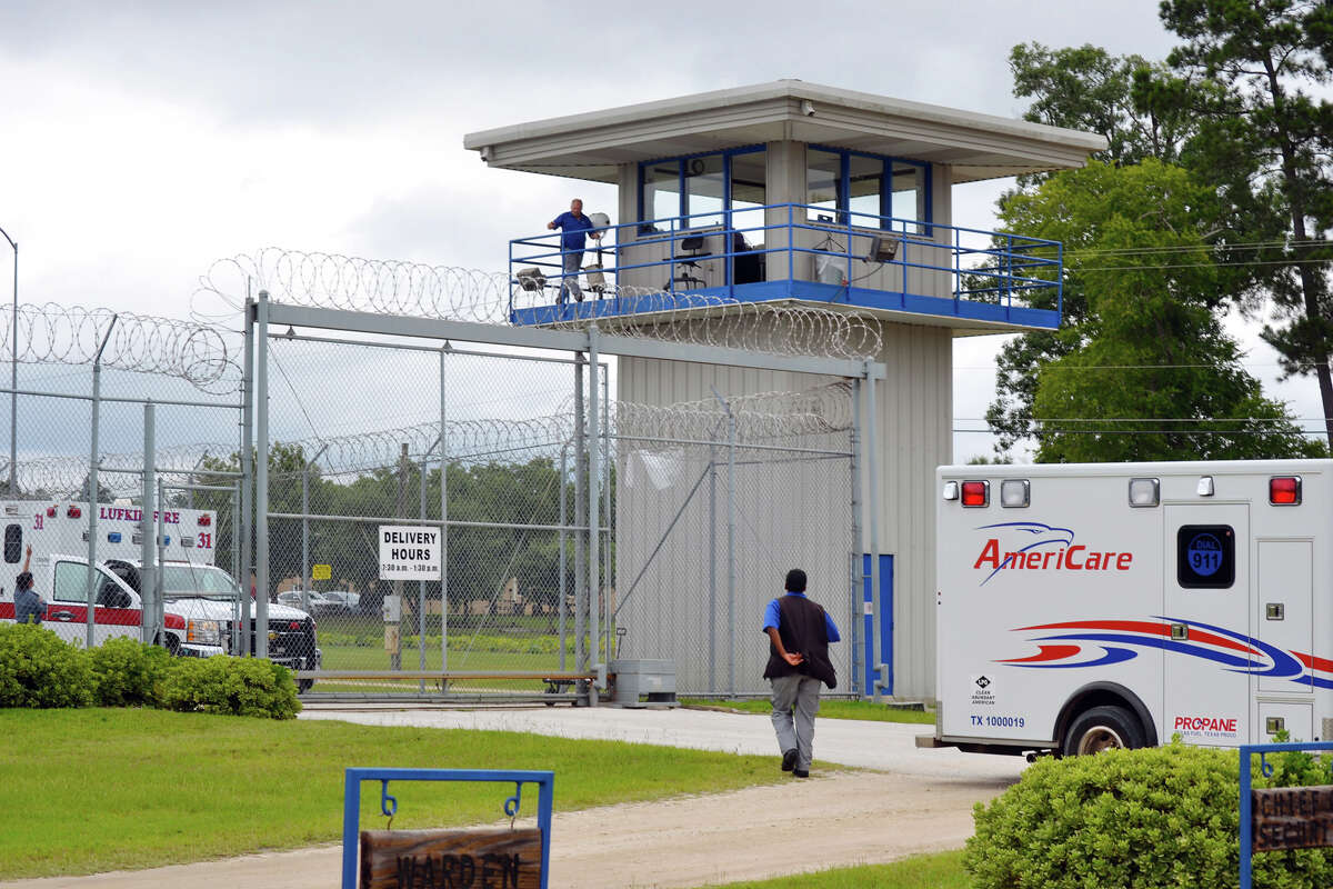 AmeriCare and Lufkin ambulances leave the scene of a ceiling collapse at the Diboll Correctional Facility on Saturday. The collapse hurt at least 19 inmates.