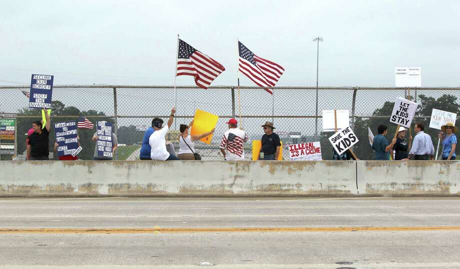 Pro and anti-immigration supporters protest Saturday in Conroe. Immigrant advocates warned that the government may be moving too quickly in deporting some who are fleeing violence in their home countries. Photo: Jason Fochtman, MBR / Conroe Courier