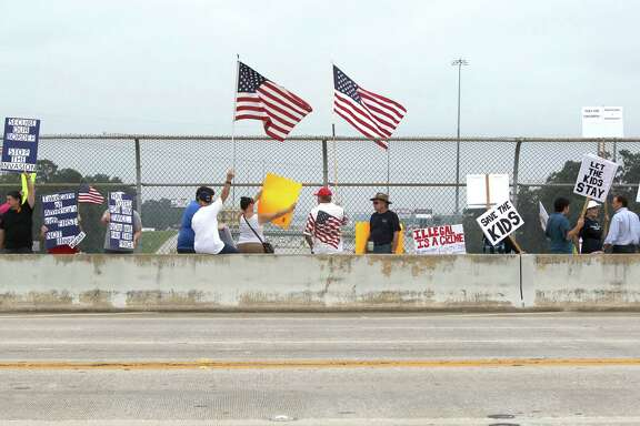Pro and anti-immigration supporters protest Saturday in Conroe. Immigrant advocates warned that the government may be moving too quickly in deporting some who are fleeing violence in their home countries.