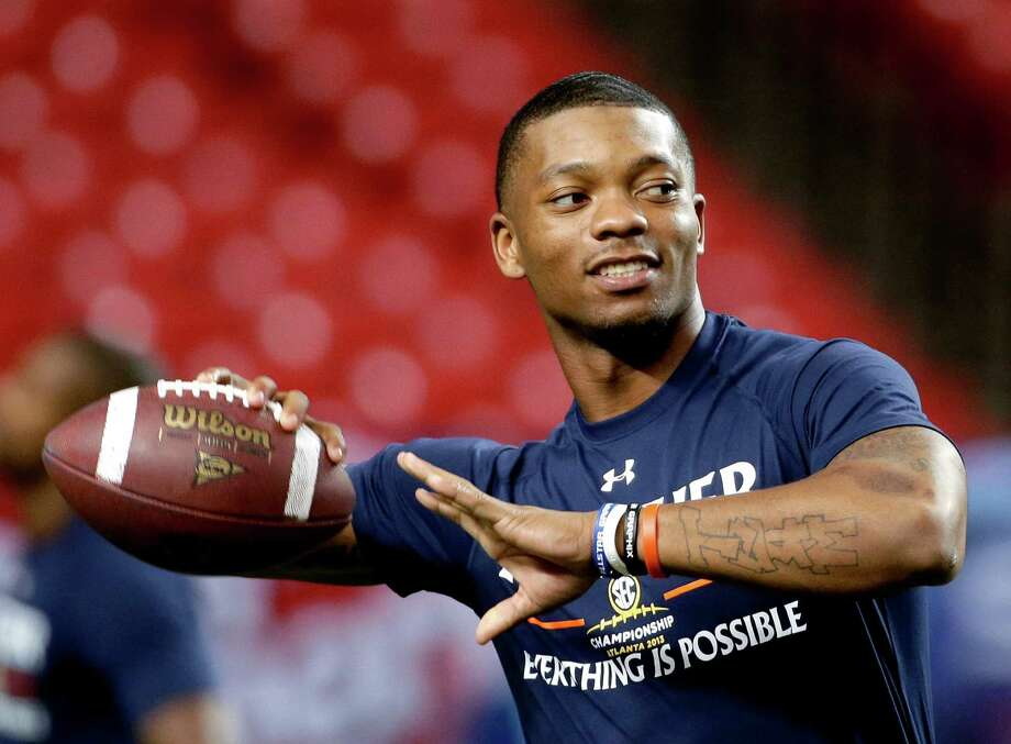 Nick Marshall, who drew headlines recently after being cited for marijuana possession, is one of the top returning quarterbacks in the Southeastern Conference after leading Auburn to the national title game. Photo: David Goldman, STF / AP