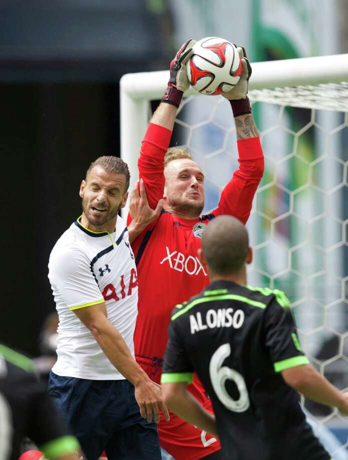 Sounders keeper Stefan Frei intercepts a cross intended for Tottenham's Roberto Soldado during the second half of Saturday's friendly in Seattle. Photo: Stephen Brashear, FRE / FR159797 AP