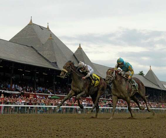 #4 Big Trouble with jockey Irad Ortiz, Jr. rides past #5 Mr. Z with jockey Corey Lanerie to win the 100th running of The Sanford Stakes Saturday afternoon July 19, 2014 at the Saratoga Race Course in Saratoga Springs, N.Y.     (Skip Dickstein / Times Union) Photo: SKIP DICKSTEIN