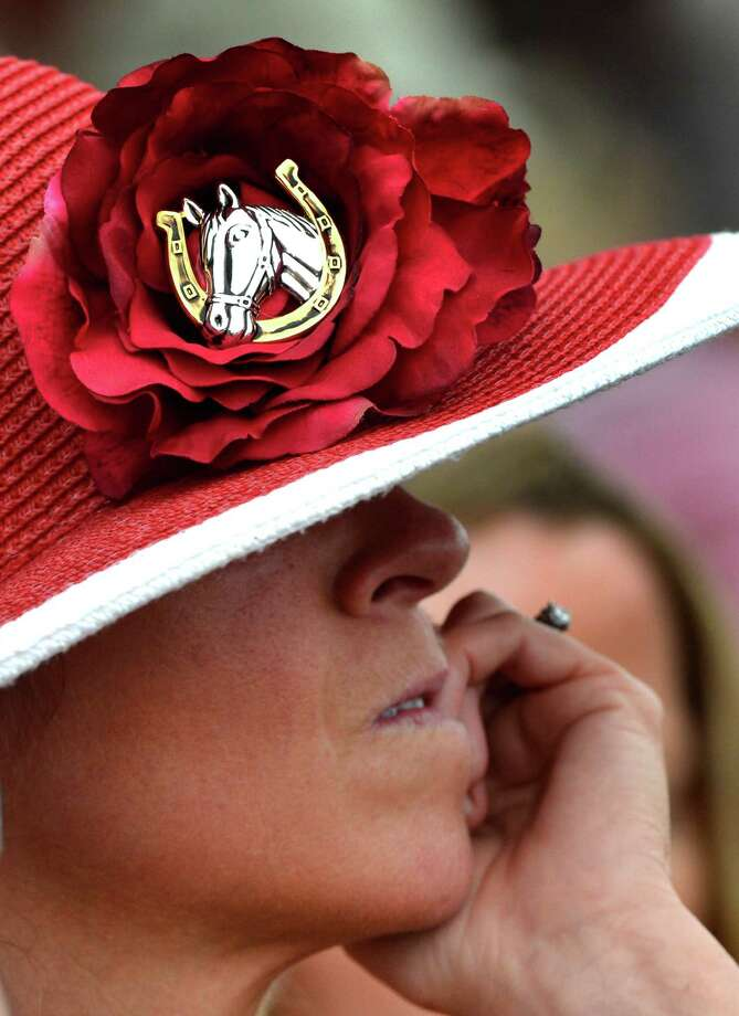 A racing patron bites her finger nails while waiting for the decision on a race Saturday afternoon July 19, 2014 at the Saratoga Race Course in Saratoga Springs, N.Y.     (Skip Dickstein / Times Union) Photo: SKIP DICKSTEIN