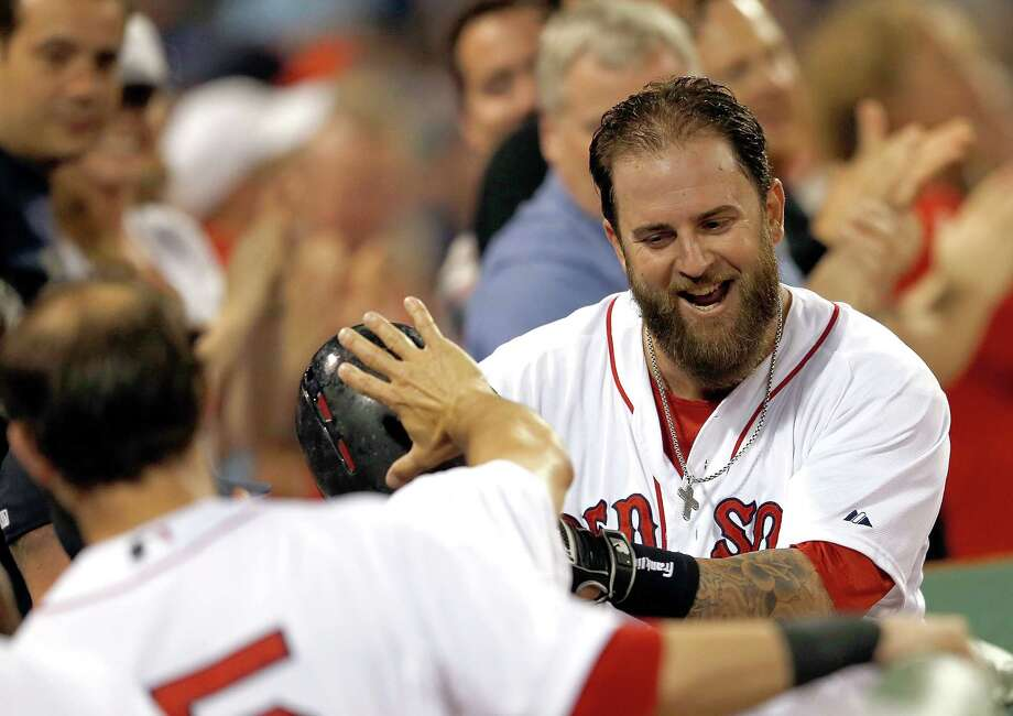 BOSTON, MA - JULY 19:  Mike Napoli #12 of the Boston Red Sox reacts after he connected for a home run in the sixth inning against the Kansas City Royals at Fenway Park on July 19, 2014 in Boston, Massachusetts.  (Photo by Jim Rogash/Getty Images) ORG XMIT: 477586459 Photo: Jim Rogash / 2014 Getty Images