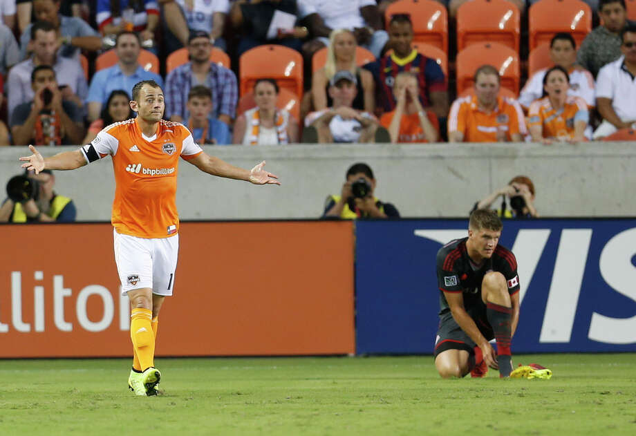 Houston Dynamo midfielder Brad Davis (11) questions a call during the first half of the MLS soccer game at BBVA Compass Stadium, Saturday, July 19, 2014, in Houston. Photo: Karen Warren, Houston Chronicle / © 2014 Houston Chronicle