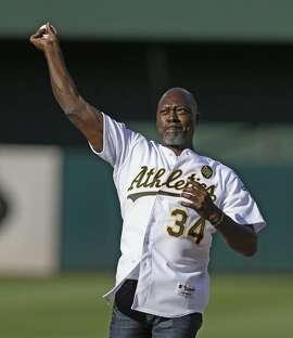 Former Oakland Athletics' Dave Stewart throws out the ceremonial first pitch during a pre-game ceremony honoring the reunion of players from the 1989 world championship team prior to the baseball game against the Baltimore Orioles Saturday, July 19, 2014, in Oakland, Calif. (AP Photo/Ben Margot)