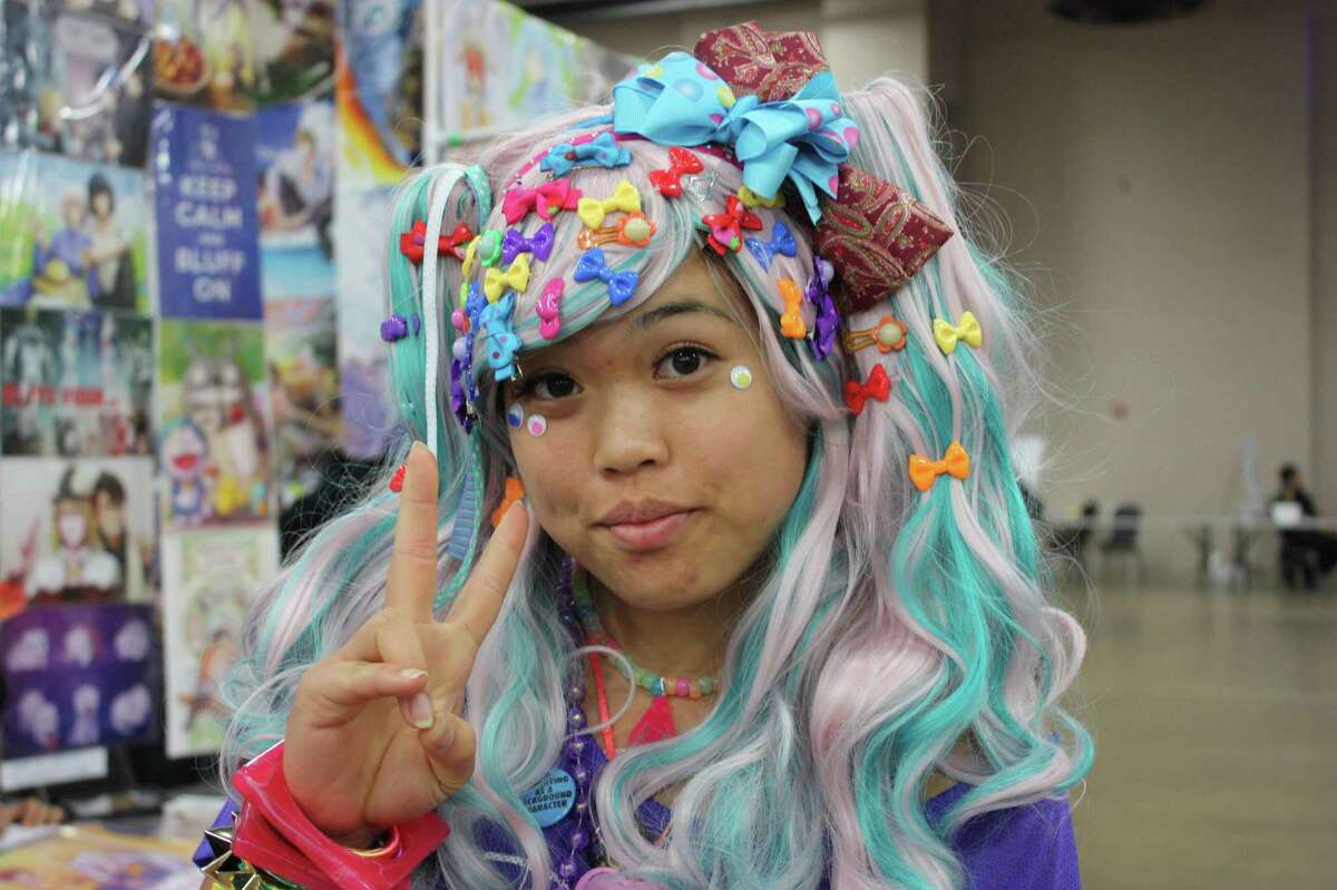 2. Rock very colorful hair. Pro tip: a crazy, colorful wig, preferably heat-resistant, is a lot simpler than hair dye.