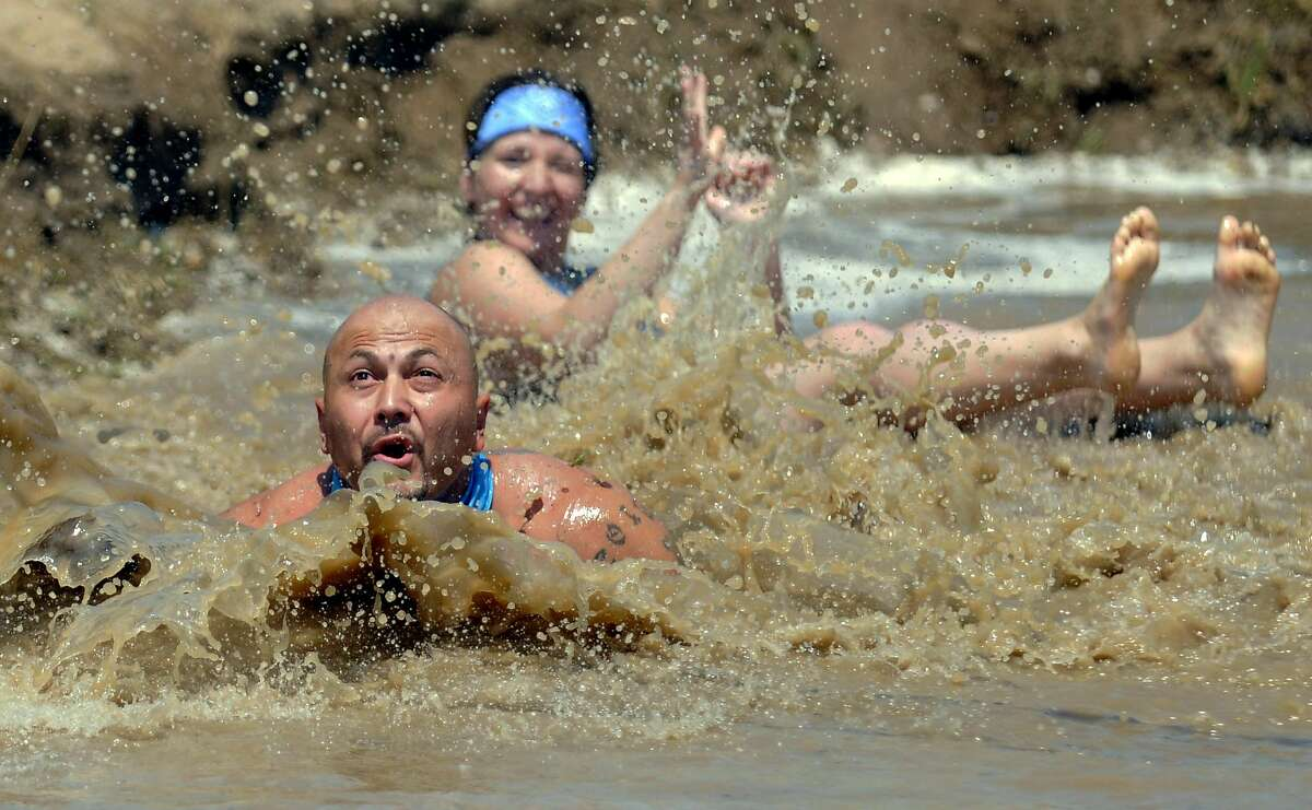 The bog of war: Jason Martinez dives for the ball during a mud volleyball tournament in LaSalle, Colo.