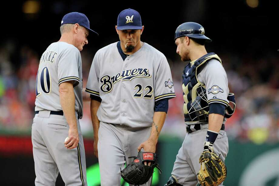 Milwaukee Brewers starting pitcher Matt Garza (22) is pulled from the baseball game against the Washington Nationals by manager Ron Roenicke (10) as catcher Jonathan Lucroy stands at right, in the first inning Saturday, July 19, 2014, in Washington. (AP Photo/Nick Wass) ORG XMIT: NAT101 Photo: Nick Wass / FR67404 AP