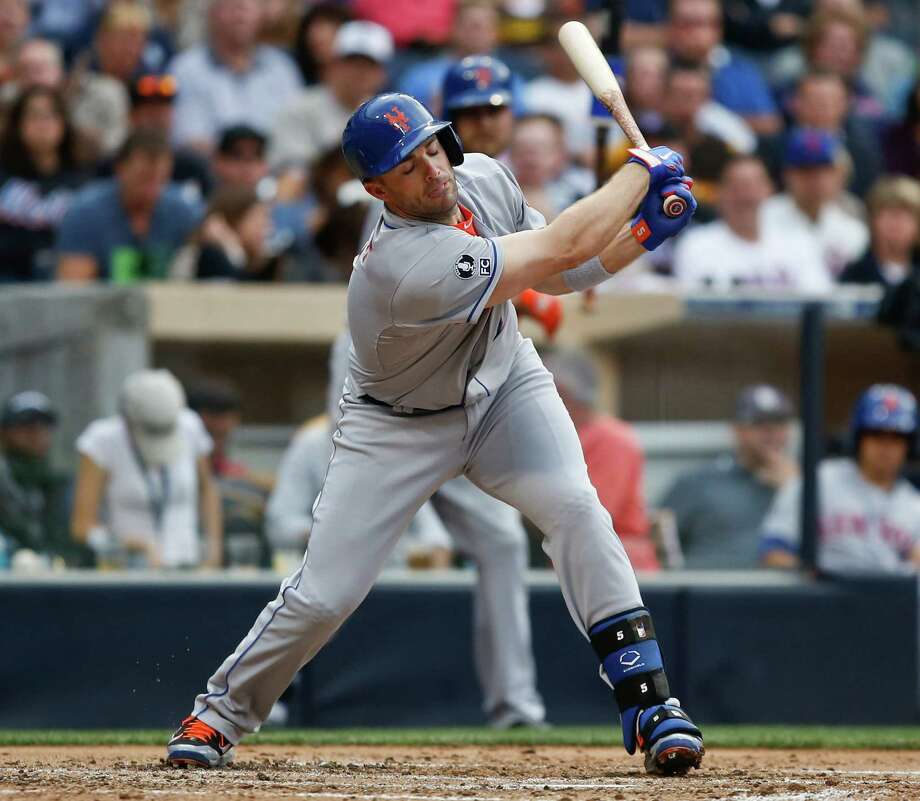 New York Mets' David Wright strikes out against the San Diego Padres, swinging at an outside pitch in the fourth inning of a baseball game Saturday, July 19, 2014, in San Diego. (AP Photo/Lenny Ignelzi) ORG XMIT: CALI105 Photo: Lenny Ignelzi / AP