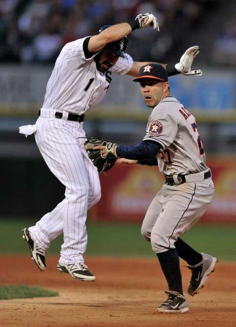 Astros second baseman Jose Altuve (27) tags out the White Sox's Adam Eaton before throwing to first to double up Alexei Ramirez in the fifth inning. Photo: PAUL BEATY, Associated Press / FR36811 AP