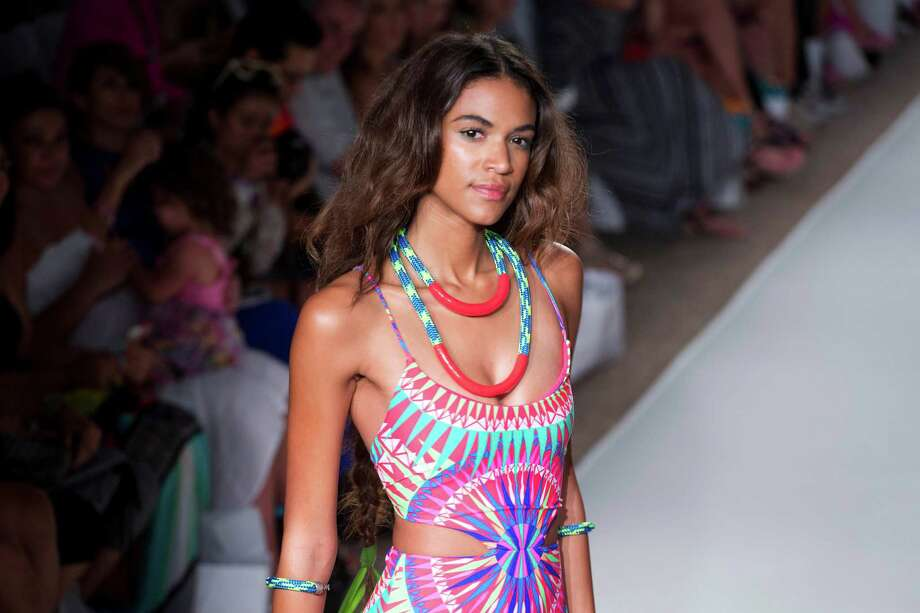 A model walks down the runway wearing swimwear from the Mara Hoffman Swim collection during the Mercedes-Benz Fashion Week Swim show, Saturday, July 19, 2014, in Miami Beach, Fla. Photo: J Pat Carter, AP / AP