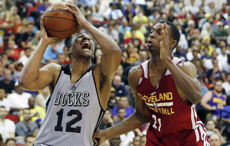Milwaukee's Jabari Parker (12) and Cleveland's Andrew Wiggins have gotten a taste of the NBA. Photo: John Locher / Associated Press / AP