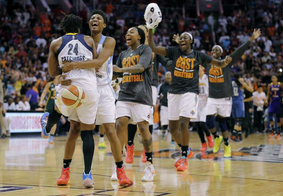 Indiana's Tamika Catchings (left) is embraced by her East All-Star teammates after hitting the game-winning basket in Phoenix. Photo: Matt York / Associated Press / AP