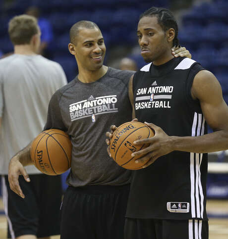 Former Spurs player Ime Udoka, with Kawhi Leonard last year, is in his second season at the helm of the Summer League team. Photo: Jerry Lara / San Antonio Express-News / ©2013 San Antonio Express-News